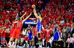 Steph Curry with the three over the outstretched hands of Ryan Anderson and Anthony Davis during Game 3 (photo courtesy of www.bigeasybeliever.com)