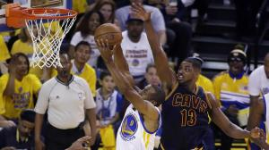 Andre Iguodala flies in for an impressive dunk versus the Cavaliers in the first quarter of Game 1(photo courtesy of www.abc7news.com)