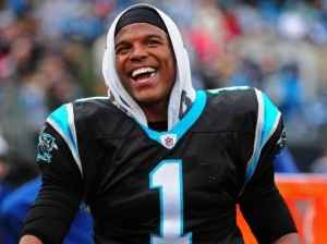 Cam Newton is all smiles after striking a huge deal with the Carolina Panthers (Photo Credit: www.sportsmasher.com)