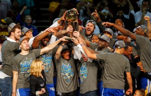 The Golden State Warriors celebrate their first title in 40 years. (AP Photo/Paul Sancya)
