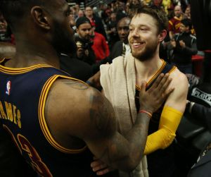 LeBron James and Matthew Dellavedova celebrate after a win. (photo credit Gus Chan of The Cleveland Plain Dealer)