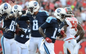 The Titans's offense celebrates a score in their 42-14 win over the Tampa Bay Bucs (Photo courtesy of Jonathan Dyer-USA TODAY Sports)